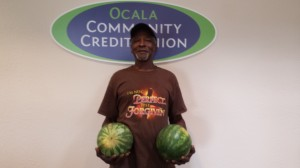 Mr Robinson gives truck load of watermelons to OCCU Staff