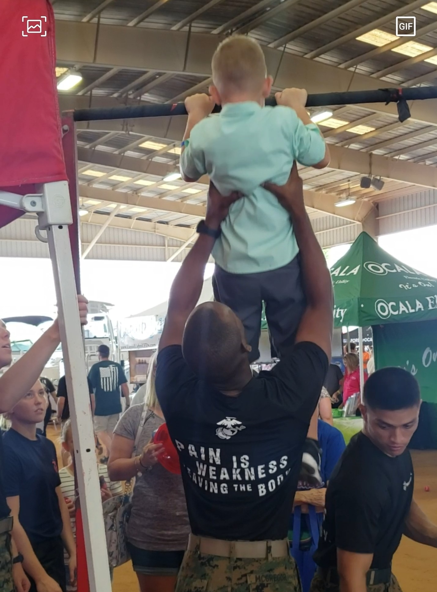 08-17-2019 Diane's Grandson with US Marines on Pull Up Bar