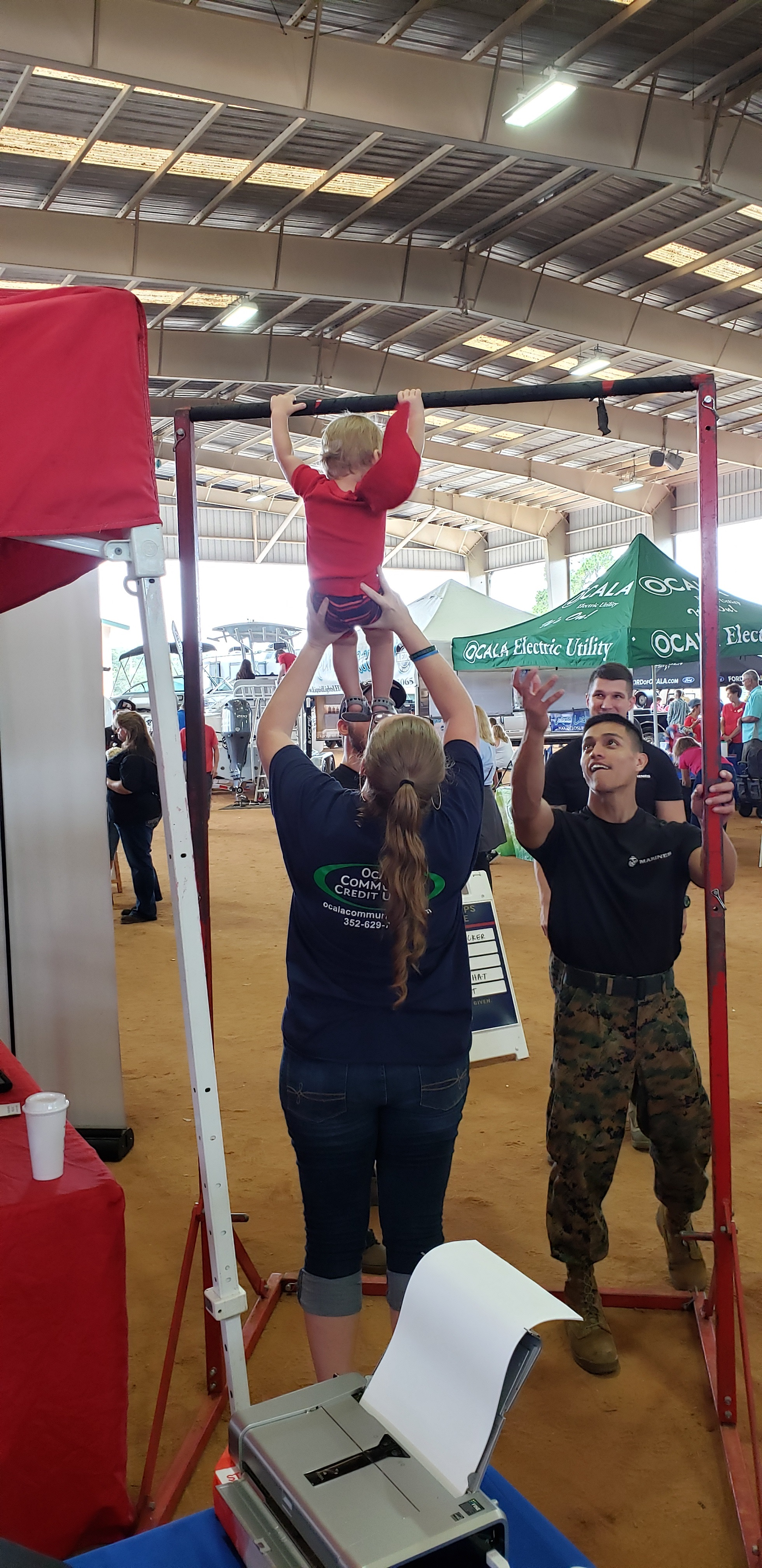 Kiah's Son w Liz on US Marine Pull Up Bar