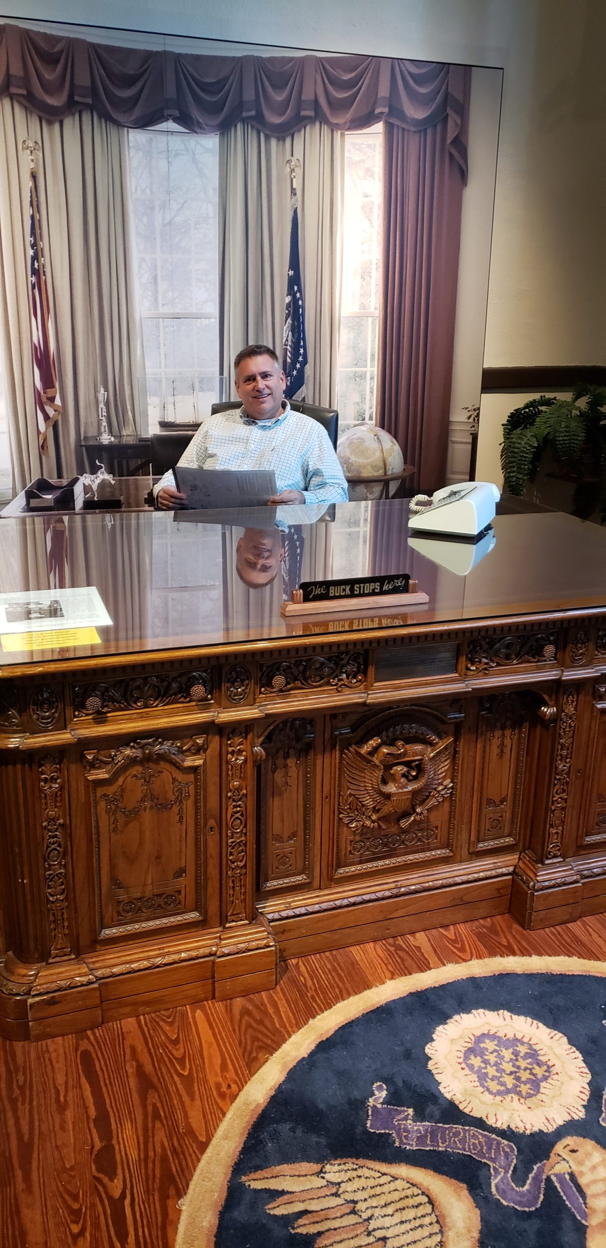 President/CEO sits @ Presidents' Desk from Oval Office